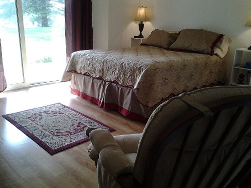 Traditional, comfortable bedroom at Bass Harbor Guest House