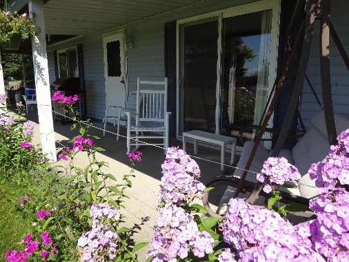 Porch with rocking chairs and purple phlox