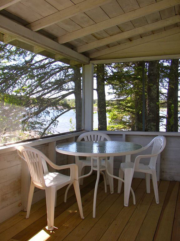 Porch, Pine Cottage, Bass Harbor Cottages and Country Inn, oceanfront, trees, vacation rental
