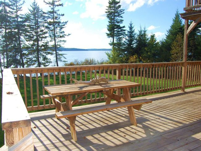 Beautiful Lodge on Carrying Place Cove, Harrington Bay, Maine Vacation Home Rental, log home, Picnic Table on Deck