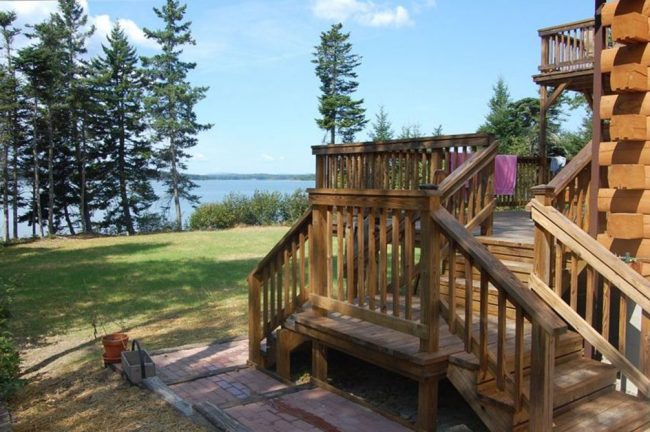 Beautiful Lodge on Carrying Place Cove, Harrington Bay, Maine Vacation Home Rental, log home, stairs to deck